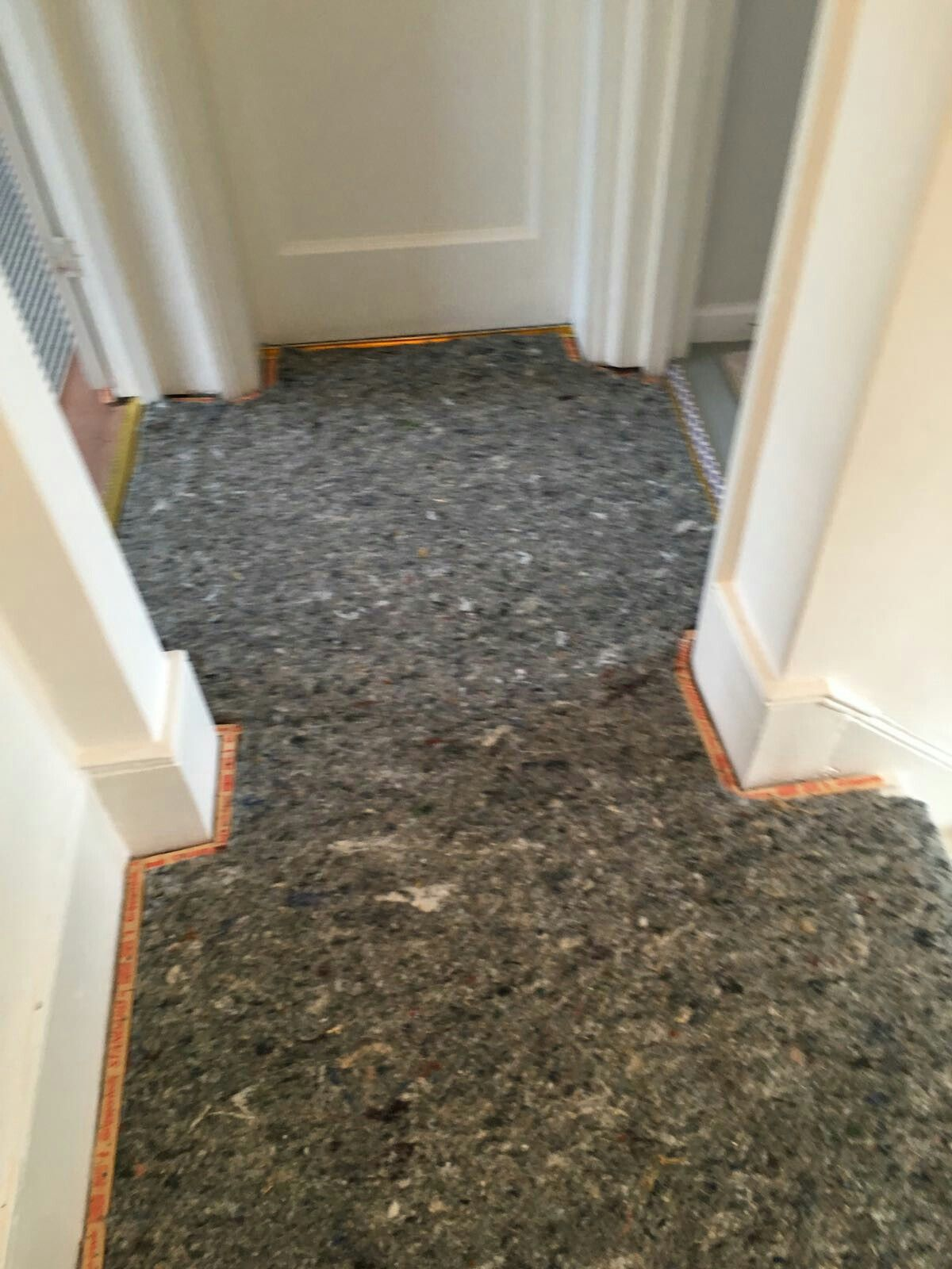 Gripper an acoustic underlay for soundproofing in a house