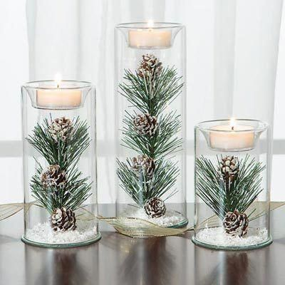 A must-have treasure! Precious clear glass Winter Tealight holders, featuring a pine branch with pinecones as the focal point, are accented with snowlike aurora borealis glitter to create an ethereal, frosty look. But when the shimmering glitter flakes catch the firelight, the effect is truly magical. Holds a single tealight (not included). Choose one, two or a set of three to create a memorable wintertime display. 2½ dia. Small - 4 h. Medium - 6h. Large - #weddingcolors