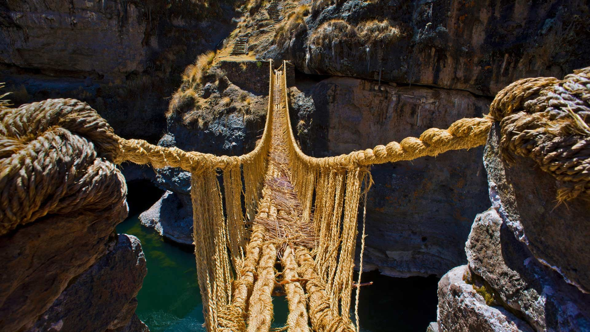 Q'iswa Chaka rope bridge over the Apurmac River, Peru Okay, this rope  bridge isn't nearly as terrifying as it looks. Brave travelers and locals  alike say ...