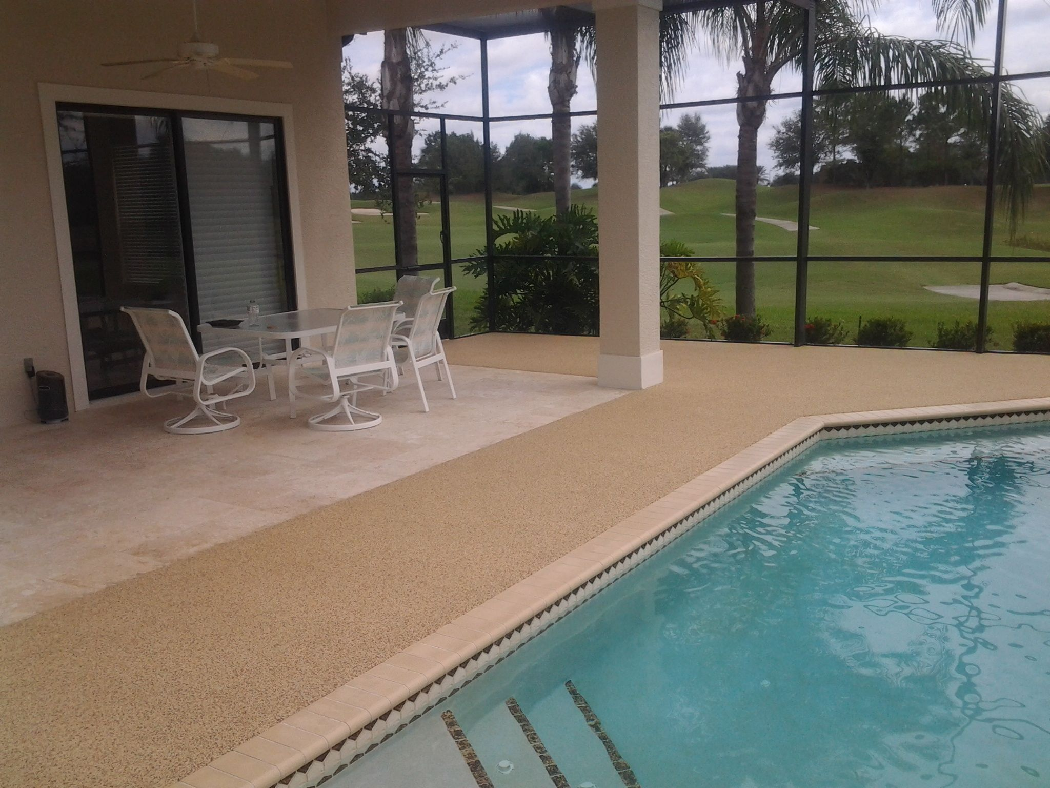 Rubber Pool Surface Around Pool Deck Area And Stone Flooring Under