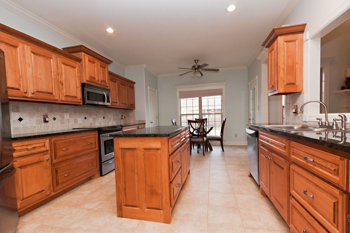 Kitchen w/ Maple Cabinets with Cherry Stain and Mocha ... on Granite Colors That Go With Maple Cabinets  id=86800