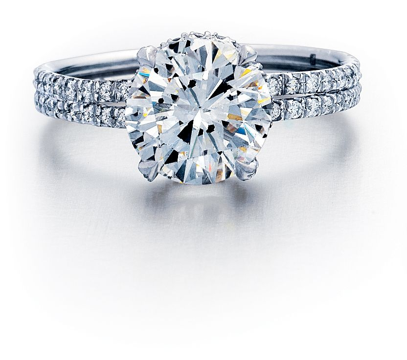 Round Brilliant Cut Diamond set in 18k white gold double shank pavé