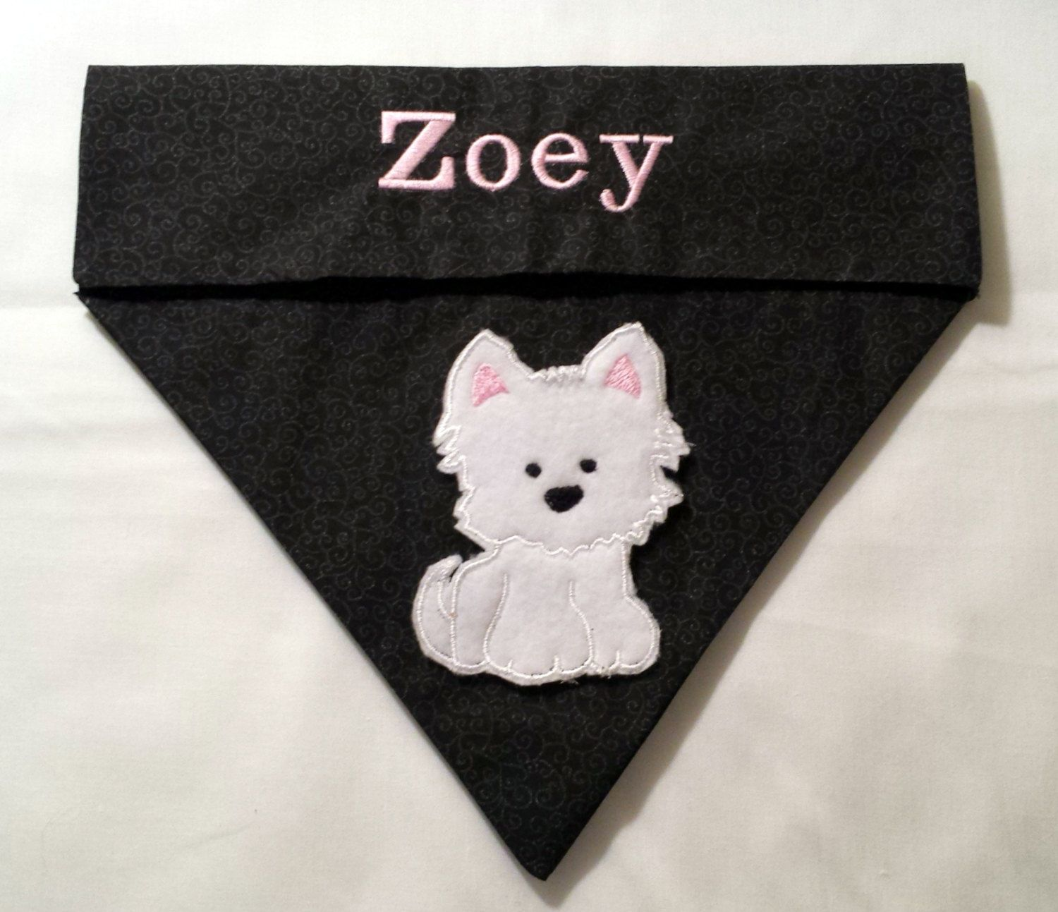 This tie on embroidered dog bandana with paw print is personalized with  your pups name and