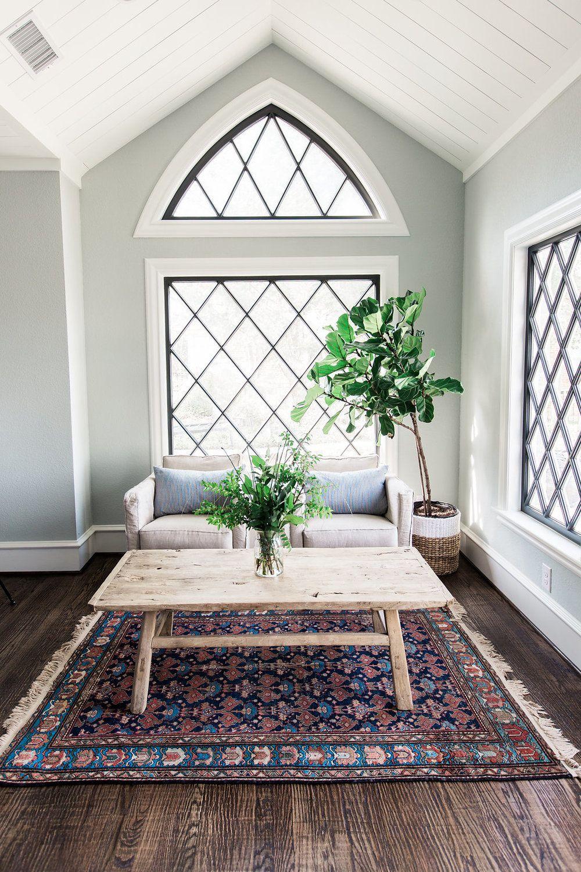 window mullions rug wood coffee table fig tree pillows comfy