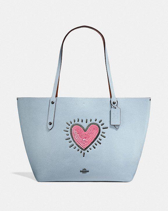 d21d392c79c5 Our favorite Keith Haring X Coach handbags  Pop art love!