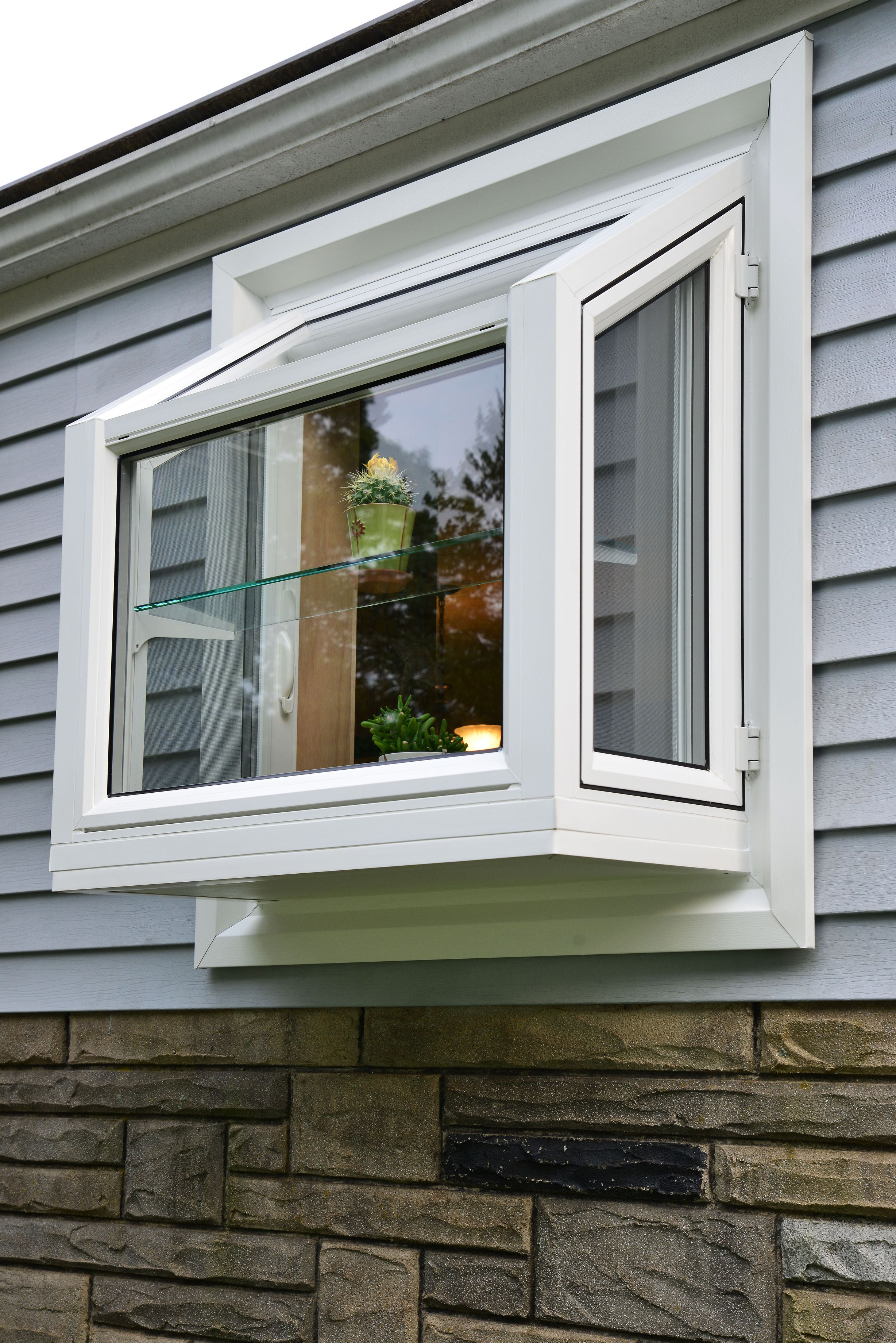 Small Garden Window Over The Kitchen Sink Exterior View