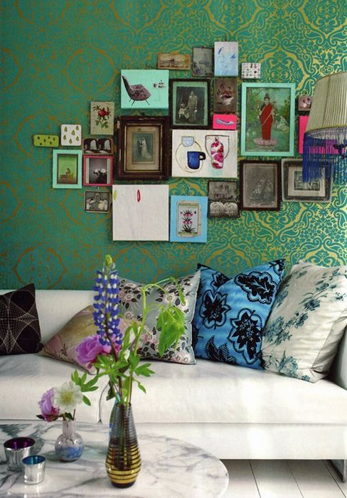 found this floating around the web years ago. I love wallpaper, the artwork, the colorful pillows, and Carrera marble coffee table.