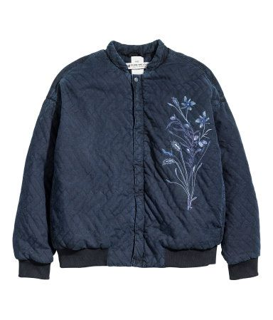 Black. CONSCIOUS. Quilted bomber jacket made from Tencel® lyocell and recycled cotton. Embroidery front and back, zip and snap fasteners at front, and
