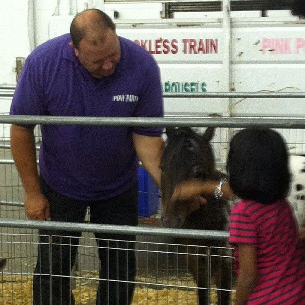 We had a great time at Market Hall today! Aaron showing Hot Rod to a child.