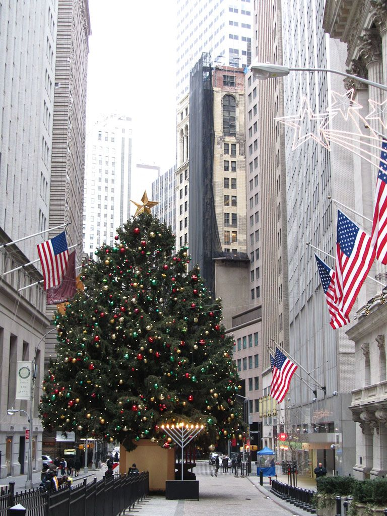 Wall Street at Christmastime tree in front of the NY