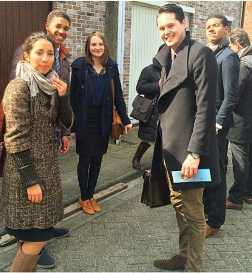 Young group Jehovah Witnesses in field service in Belgium