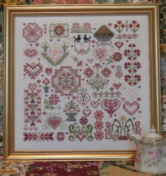 hearts of the kingdom is the title of this cross stitch