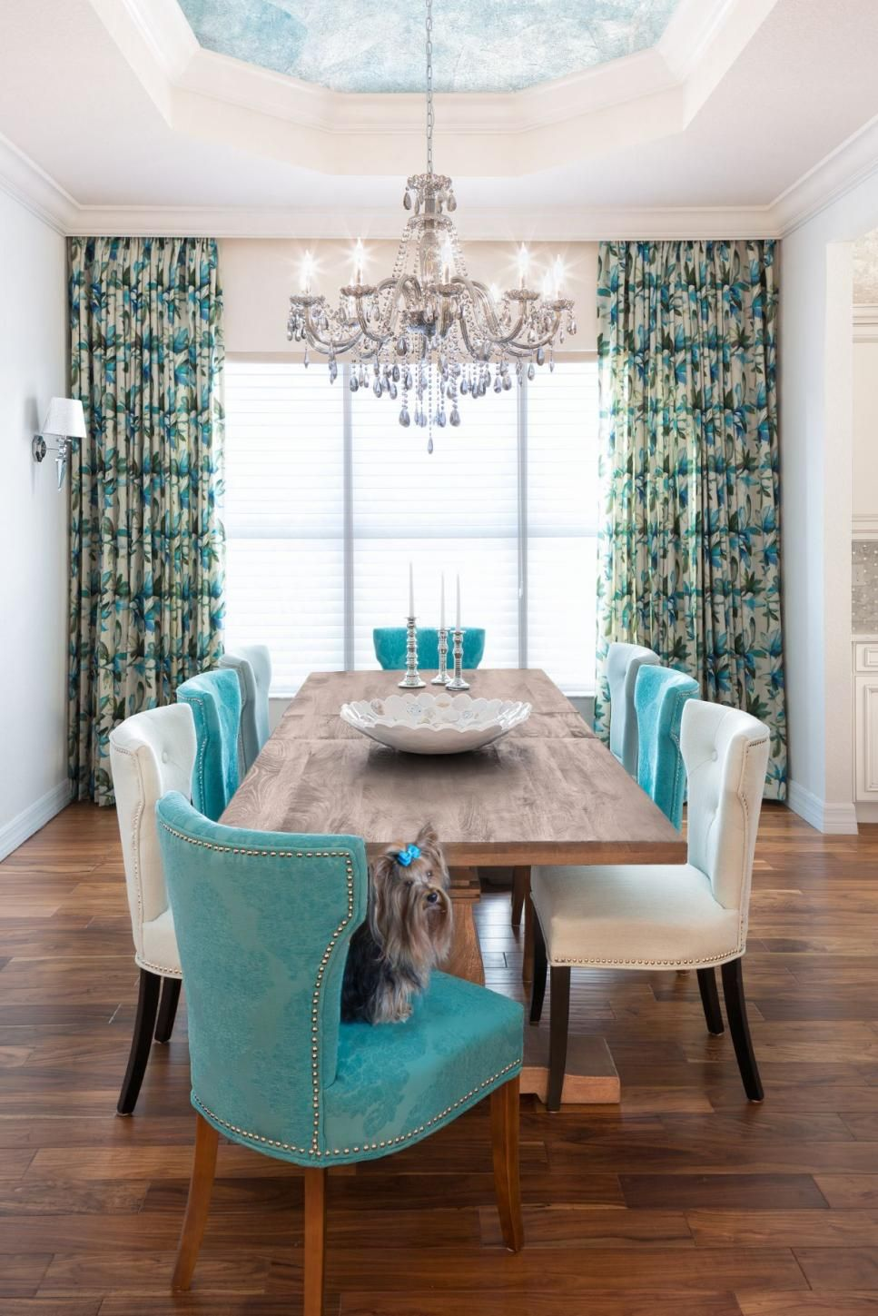 Alternating Turquoise And White Chairs Surround A Long Rustic Dining Table While A Sophisticated C Turquoise Room Turquoise Dining Room Living Room Turquoise