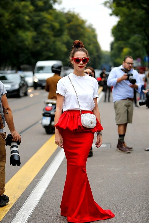 dropping a red floor length number with a white tee. pay that. Milan.