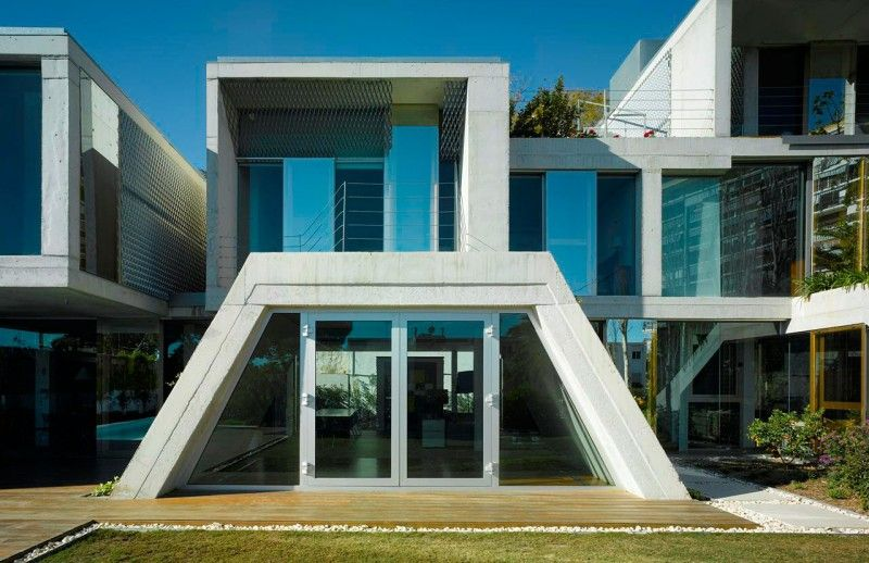 Architecture trapezoid house shape wiht glass door with for Find architecture