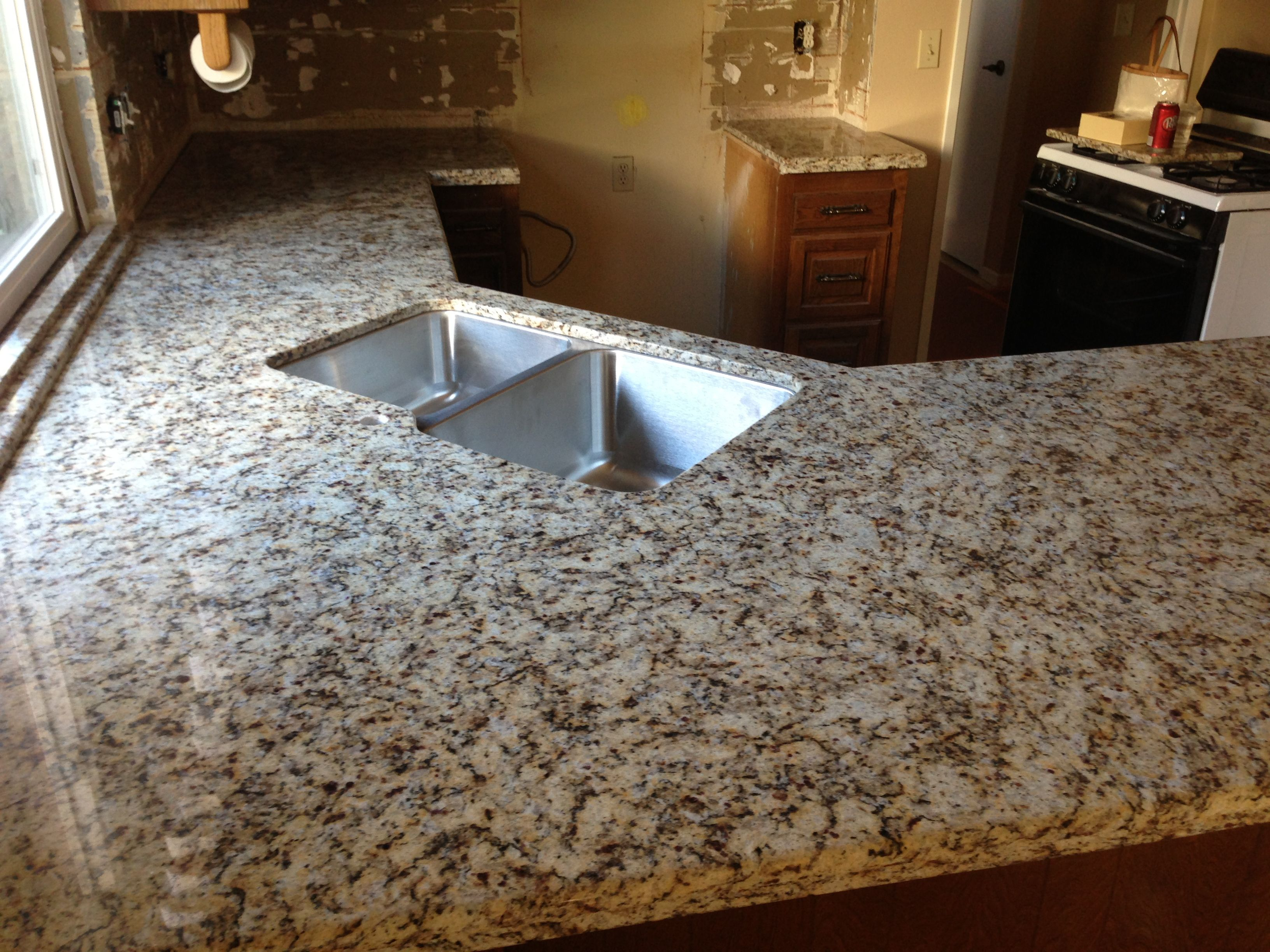New Granite Countertop Installed. Giallo Napoli. Tumbled Travertine To Be  Installed On Backsplash