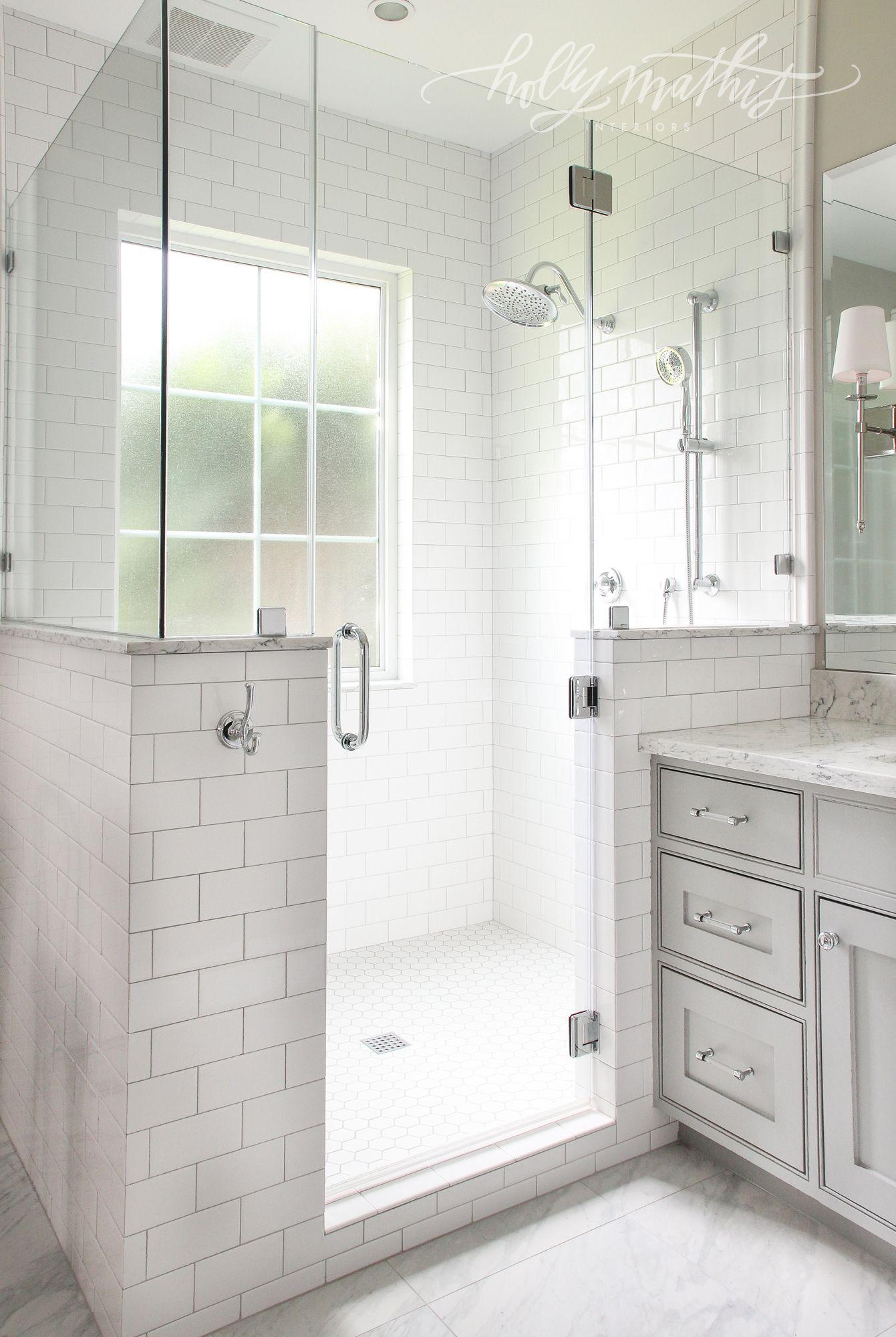 window in shower, half wall, frameless shower door. Holly