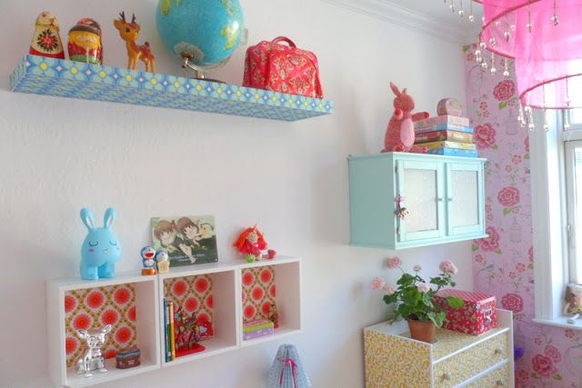 use scrapbook paper, wrapping paper, etc. to add color to bedroom shelving