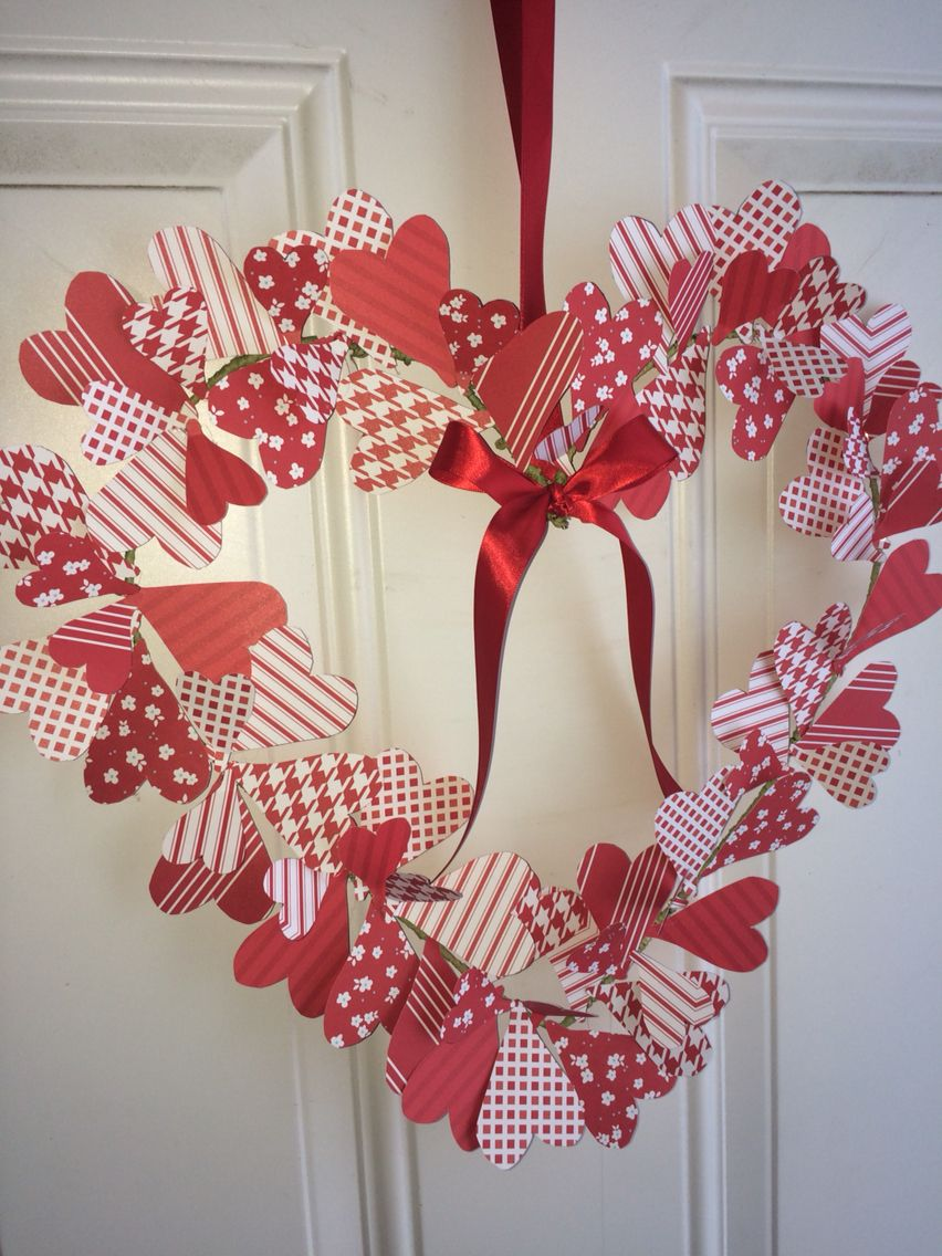 Valentine's Day wreath from a hanger and scrap book paper.  Took a lot of time but very easy!