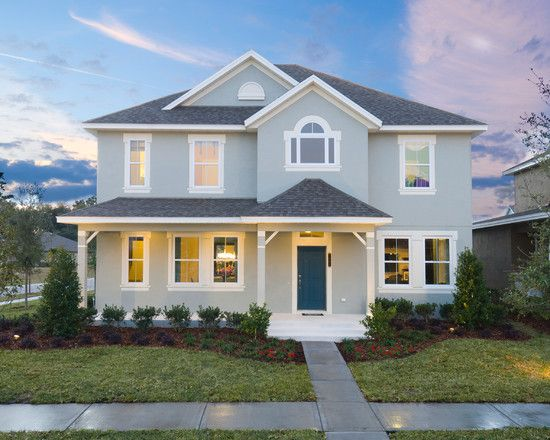 Traditional soft blue home with a classic dark blue door - Dunn edwards paint colors exterior ...