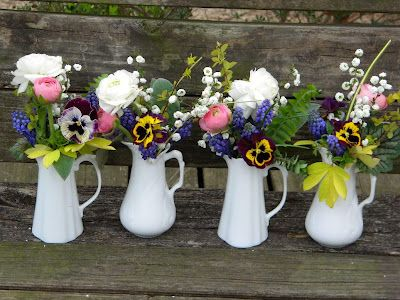 Pretty Maids all in a Row- Creamers filled with springtime flowers from the garden