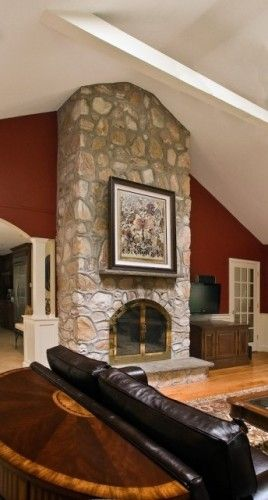 Large Rough Large Stone Fireplace With Raised Hearth Sofa Wall