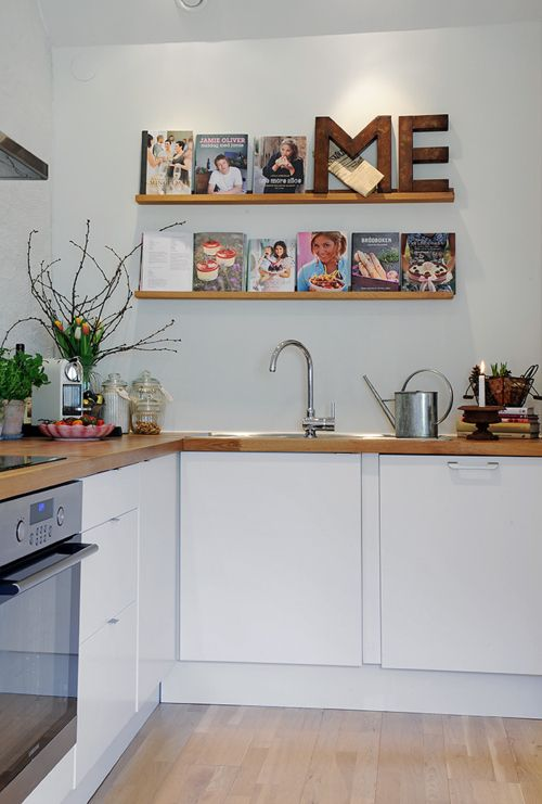 like the idea of displaying cookbooks like that-- add iron letters that spell EAT