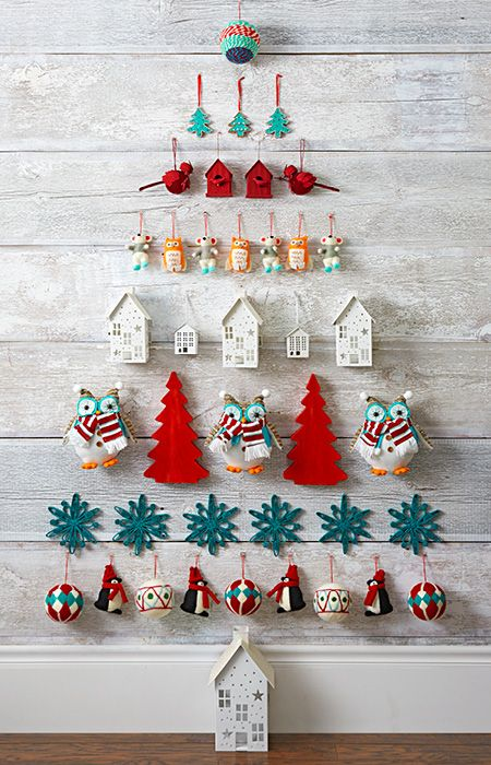 Rows Of Hanging Holiday Ornaments Narrow To A Point Forming The Shape Of A Wall Ch Wall Christmas Tree Wall Hanging Christmas Tree Christmas Decorations Cheap