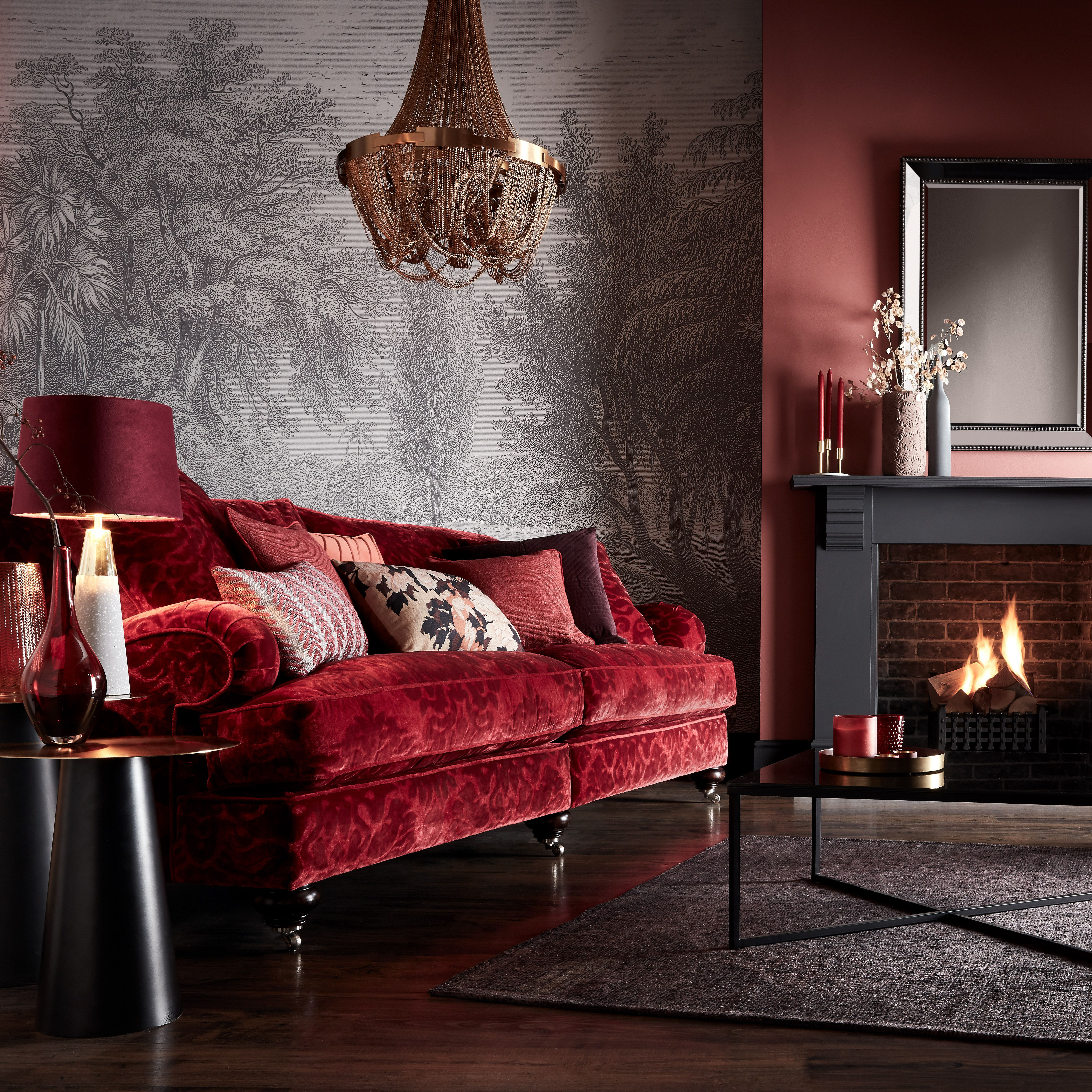 Christmas Is A Time For Relaxation Light The Fire Curl Up On A Red Velvet Sofa And Unwind In Cosy Red Sofa Living Room Red Sofa Living Red Couch Living Room
