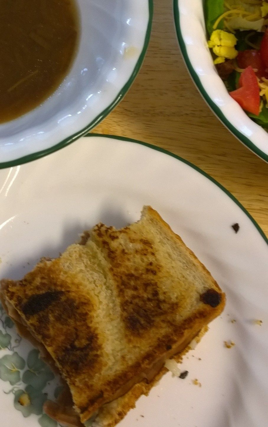 Grilled roast beef and mozzarella cheese sandwich.  Dipping sauce; French onion soup or au jus.