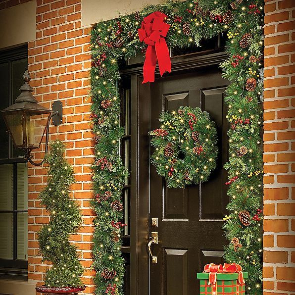 looking for an easy way to decorate your door a lighted christmas wreath and doorway arch are the perfect solution