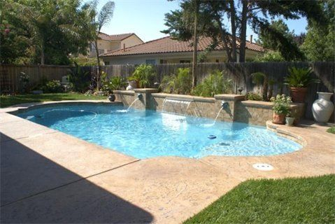 Water Wall Feature With Roman Shaped Pool Pool Landscaping Pool Designs Backyard Pool Landscaping