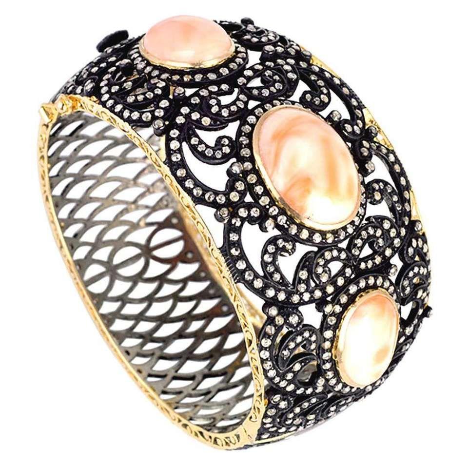 Coral diamond bangle