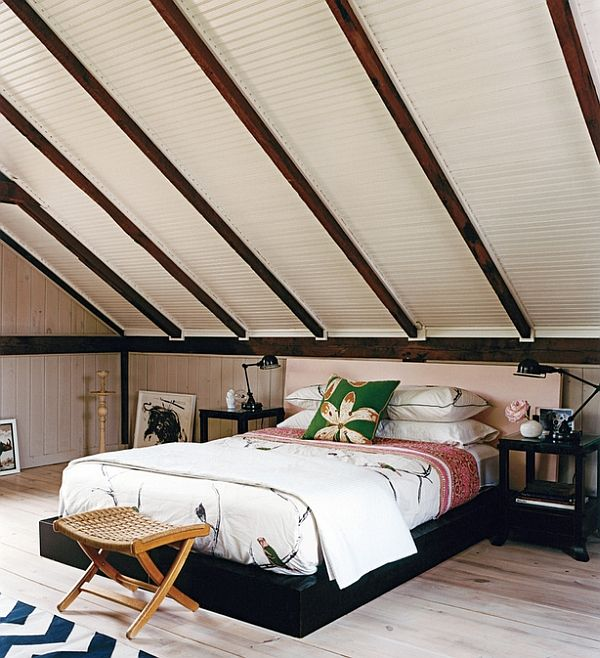 Low Slung Decor Makes This Bedroom Visually Appealing Attic Bedroom Designs Slanted Ceiling Bedroom Rooms With Slanted Ceilings