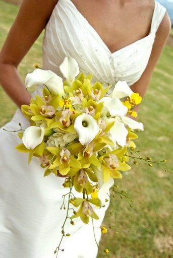 Mini calla lillies, mini cymbidium orchids, oncidium orchids and hydrangea teardrop shaped bouquet.  theSNAPsisters Photography  Floral design by Kim Zylstra from www.thebackyardgardener.net