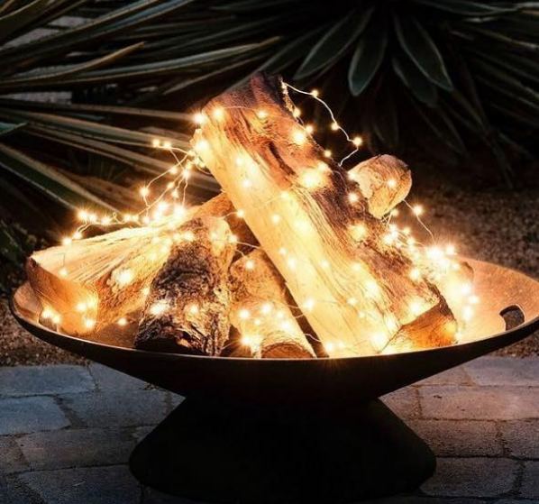 This Stylist Put Christmas Lights In Her Fireplace And It S Sheer Genius Holiday Lights Outdoor Backyard Lighting Outdoor Christmas