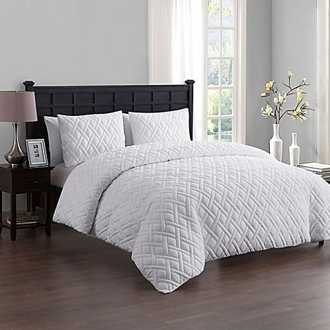 Create a space where you can relax and unwind with the refined VCNY Home Lattice Duvet Cover Set. Featuring a subtle embossed detail, the set boasts neutral, muted tones for a simple, yet sophisticated look complete with matching shams.