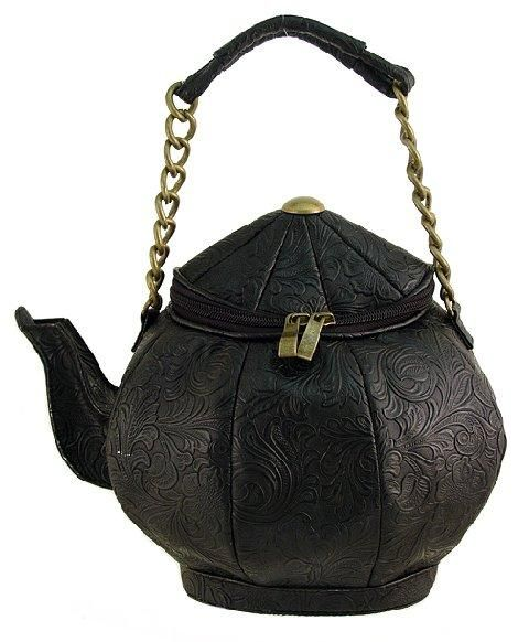c48a927e822 This Is such a unique bag, it's a tea pot!This bag is black with a black  damask pattern. On the top it has the black zippering and gold pulley  things.