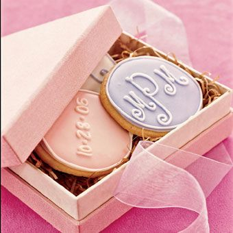 Possible favor for Amandas shower. Purple and silver icing with initials and date of wedding.  Purple box, silver ribbon.