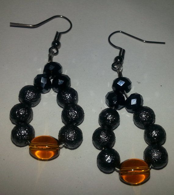 Check out this item in my Etsy shop https://www.etsy.com/listing/250719648/black-textured-dangle-earring-with-brown