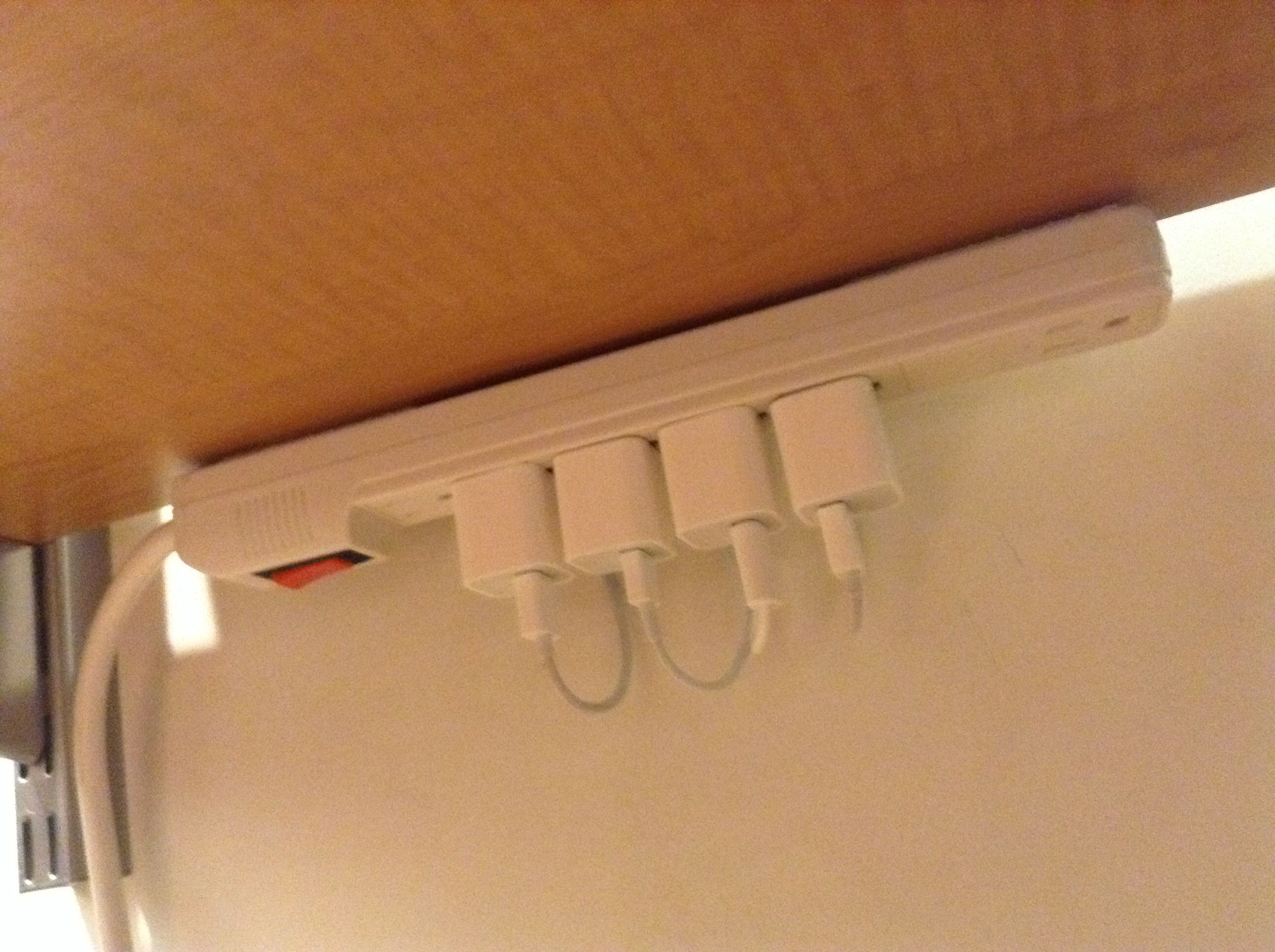 Use Velcro Command Strips To Attach Your Power Strip To The