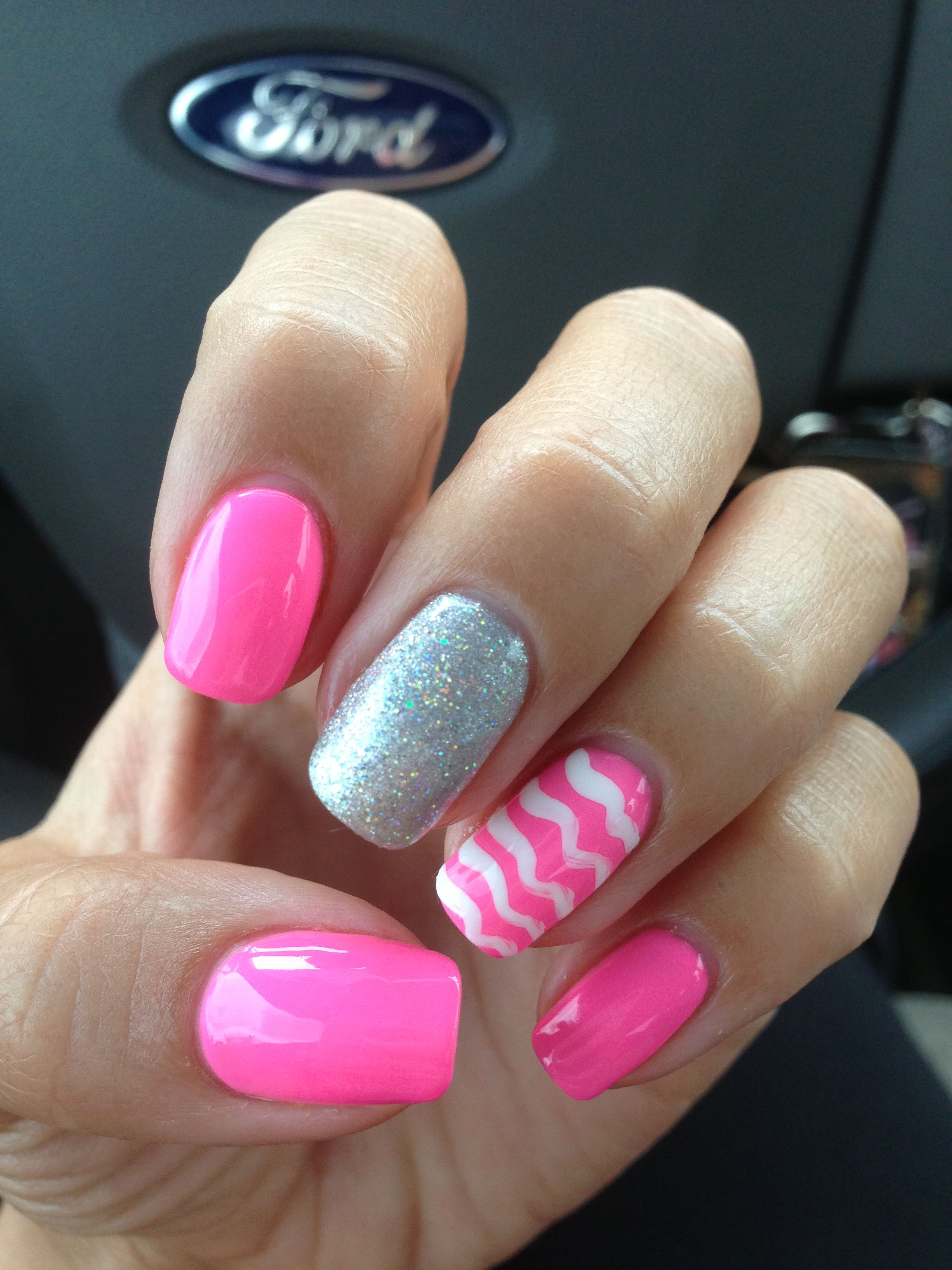 My pink, sparkle, and chevron, shellac nails!