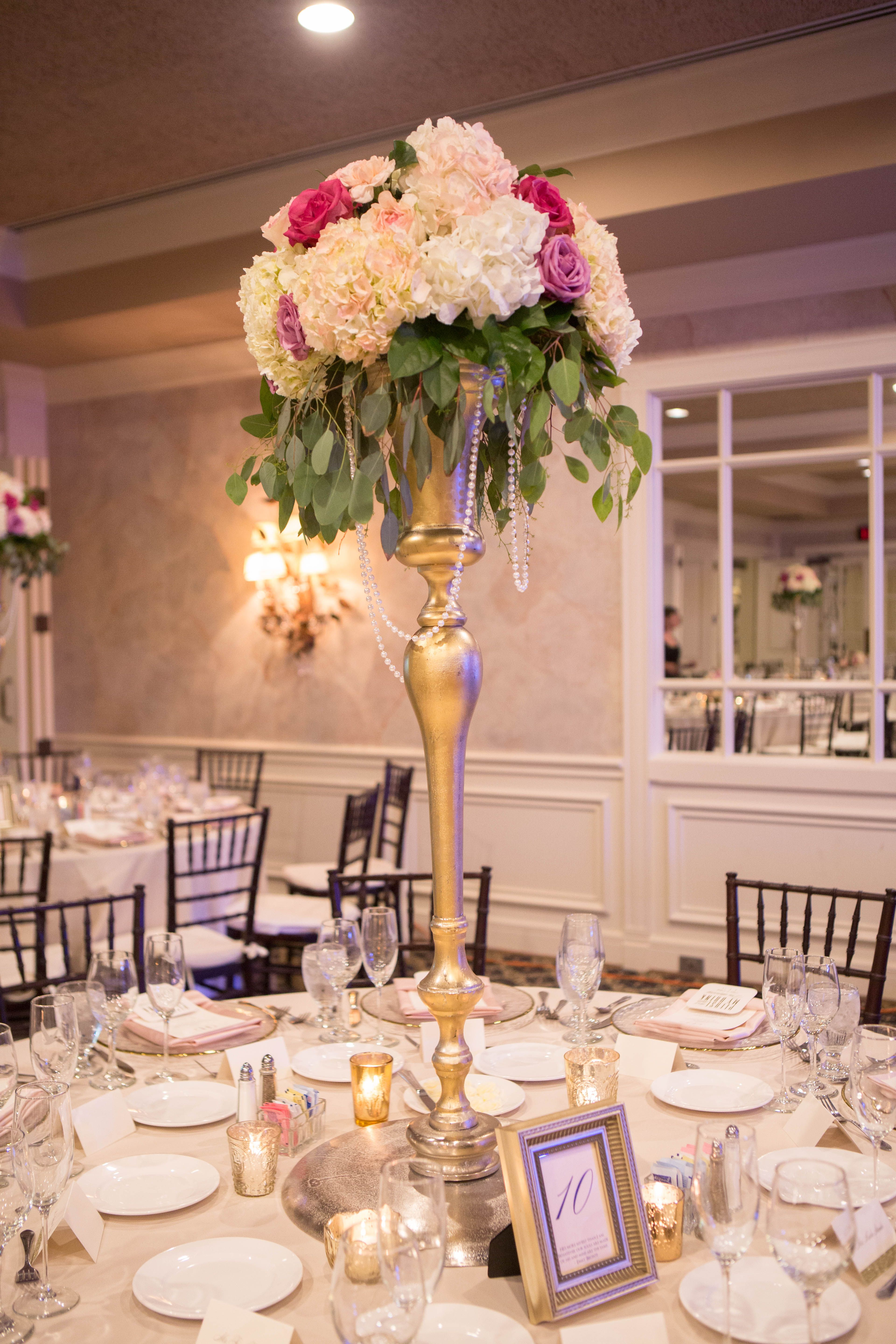 Tall Gold Centerpiece With Pink and Ivory Flower Arrangement