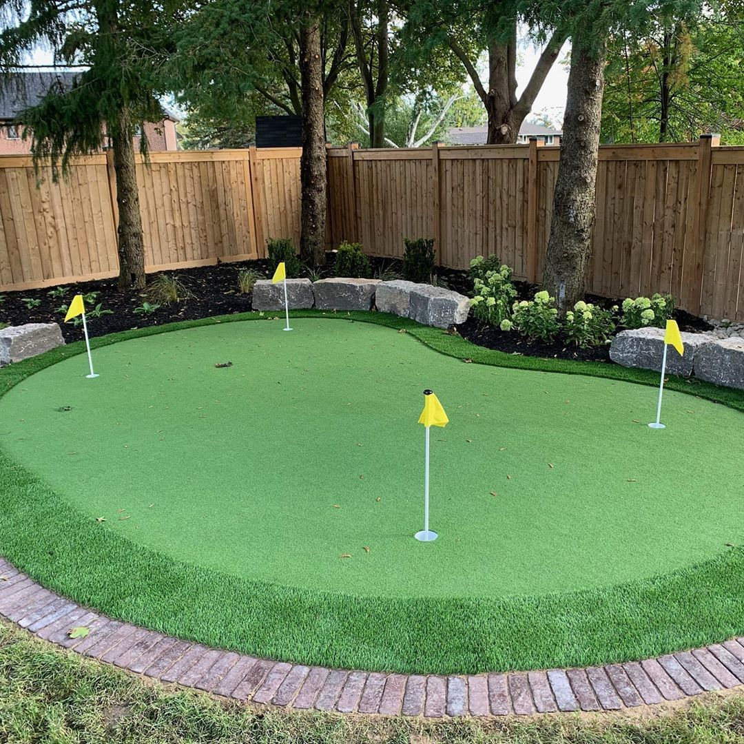 Shades Of Green Landscaping On Instagram Step Up Your Golf Game With A Backyard Putting Green Need In 2020 Backyard Putting Green Green Backyard Backyard