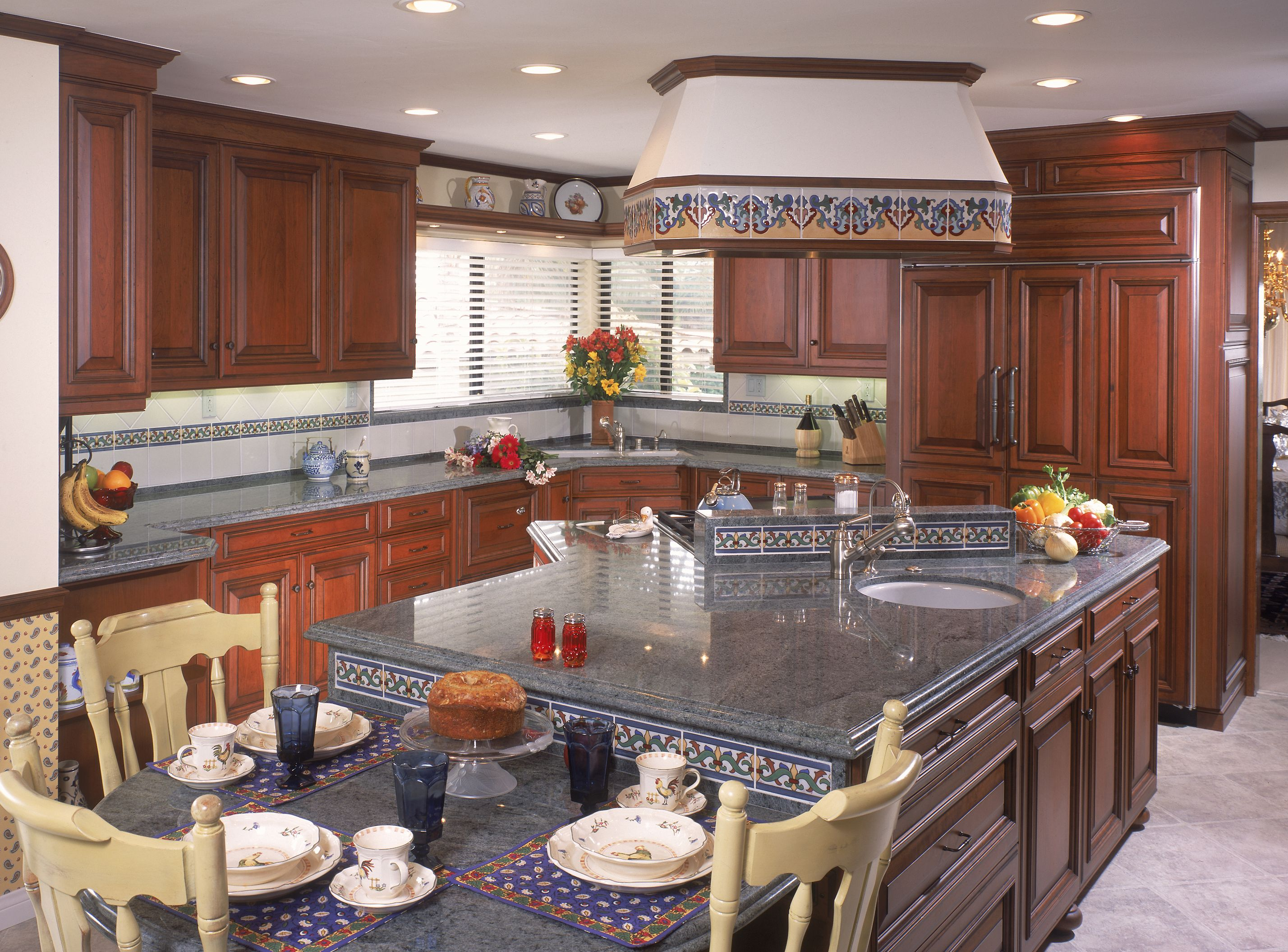Island with diagonal cooktop and ceiling hood extended - Kitchen island with cooktop and seating ...