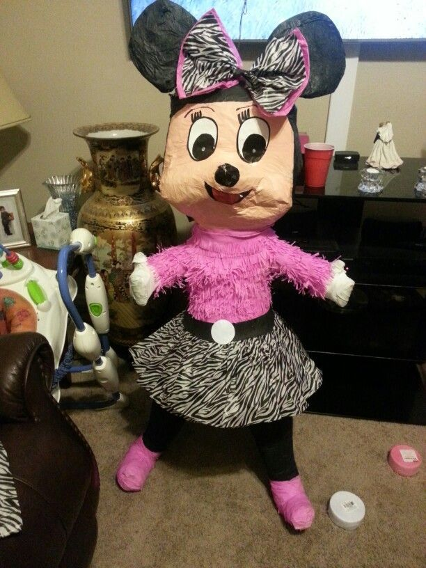 Added a zebra print skirt and bow to minnie mouse pinata