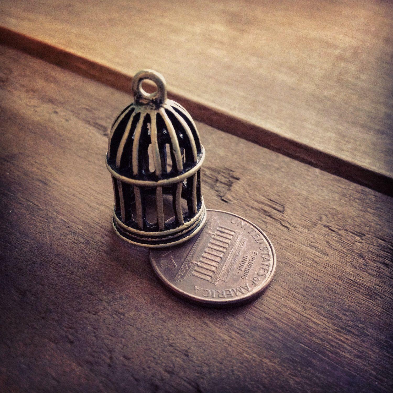 4 - Birdcage Charms Antique Bronze Birdcage Charm Bird Charm Small Charm Bird Cage Charm Vintage Style Pendant Charm Jewelry Supplies. $3.50, via Etsy.