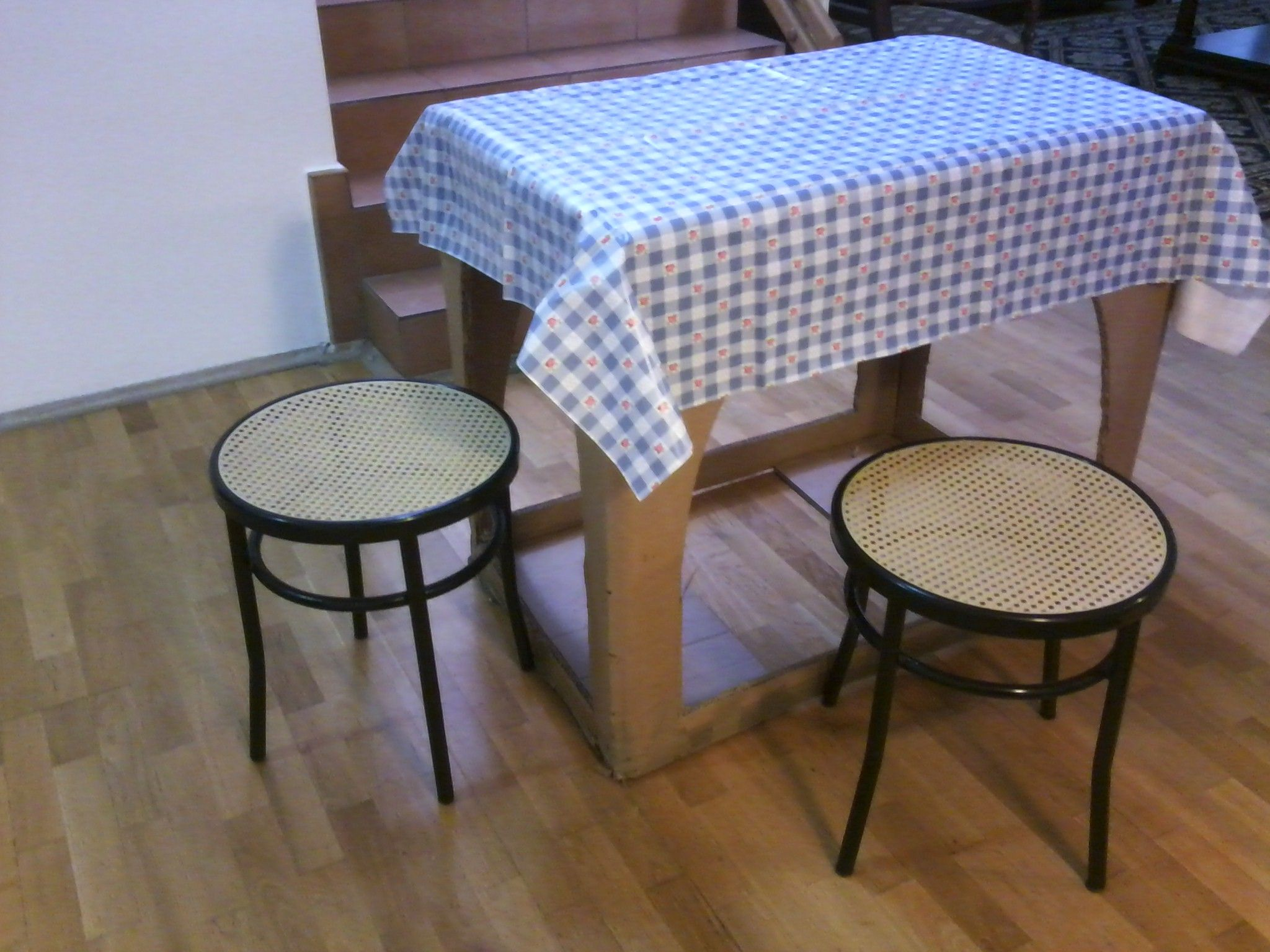 Table cloth and stools- voila. Packing box to furniture, to use until the actual furniture arrives.