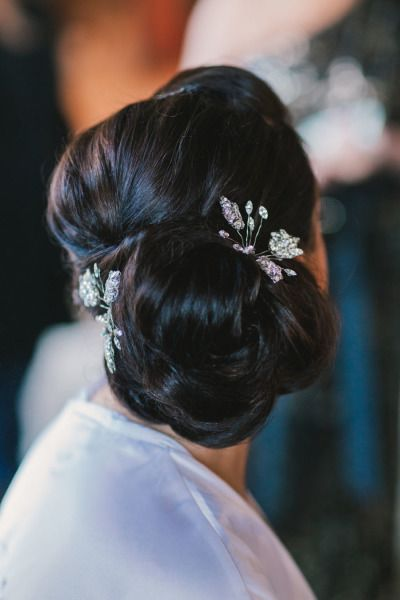 Updo and crystal hairpieces: http://www.stylemepretty.com/florida-weddings/2014/05/14/garden-elegance-at-bella-collina/ | Photography: By the Robinsons - http://www.bytherobinsons.com/