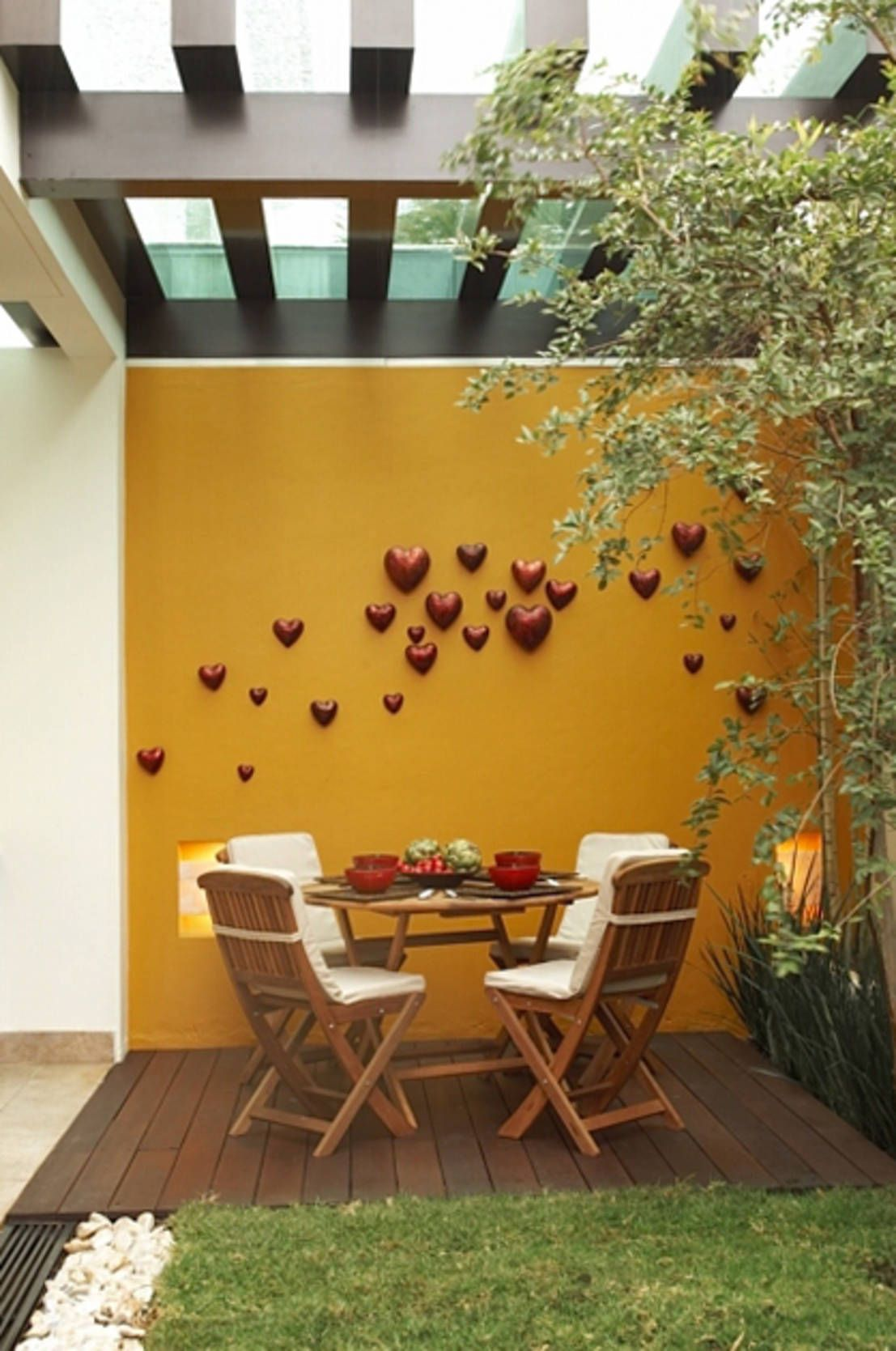 Deck balcones y terrazas modernos de arketipo taller de - Decoracion muros exteriores ...